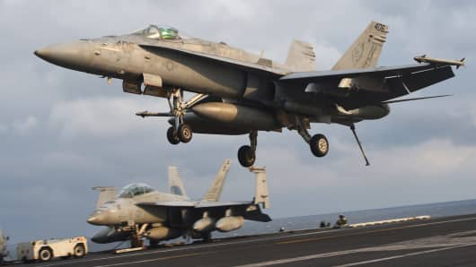 An F/A-18 fighter lands on the deck of the Nimitz-class aircraft carrier USS Carl Vinson during a South Korea-US joint military exercise in seas east of the Korean Peninsula.