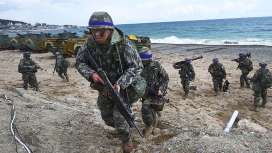 South Korean Marines move into position on a beach during a joint landing operation by US and South Korean Marines in the southeastern port of Pohang, Korea.