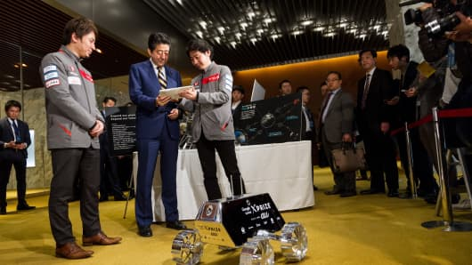 CEO of ispace Takeshi Hakamada speaks to Japan's Prime Minister Shinzo Abe at government-hosted event in Tokyo.