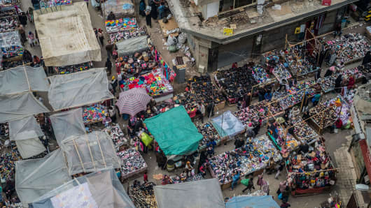 Street vendors sell shoes at the Al-Attaba market in the centre of Cairo, Egypt, on February 21, 2018.