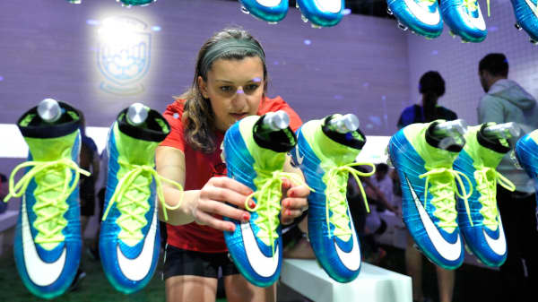 A soccer fan grabs a shoe at The Nike Underground, a pop-up experience in downtown Vancouver.