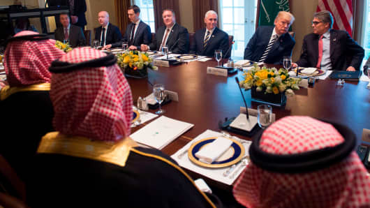 President Donald Trump (center R) holds a lunch meeting with Saudi Arabia's Crown Prince Mohammed bin Salman (center L), and members of his delegation, in the Cabinet Room of the White House in Washington, DC, March 20, 2018.