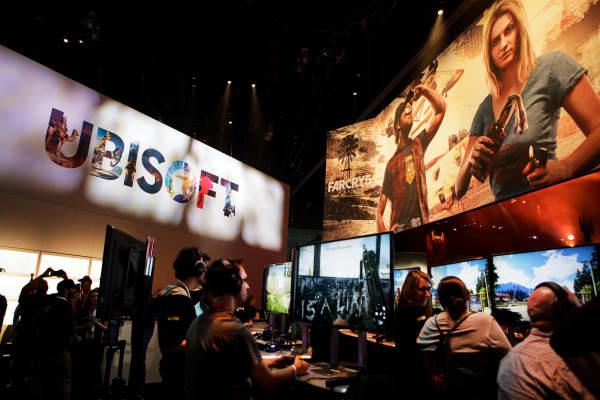 Attendees play the 'Far Cry 5' video game by Ubisoft Entertainment SA video games during the E3 Electronic Entertainment Expo in Los Angeles last June.