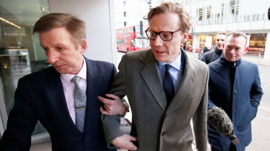Alexander Nix, CEO of Cambridge Analytica, center, arrives at the offices of Cambridge Analytica in central London, Britain, March 20, 2018.