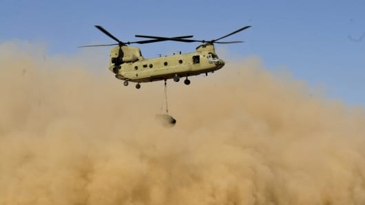 A U.S. Army CH-47F Chinook helicopter attached to the 25th Combat Aviation Brigade takes off during a training exercise.