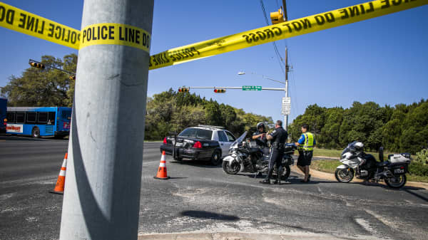 Police tape marks off the neighborhood where a package bomb went off on March 19, 2018 in Austin, Texas.