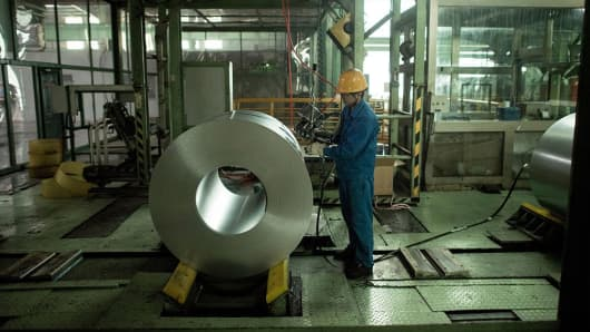 A Chinese worker packs steel rolls in a steel factory in Tangshan, Hebei province.