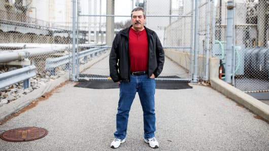 """Only two weeks after IBM laid him off in December 2016, Ed Miyoshi of Hopewell Junction, New York, started work as a subcontractor to the company. But he took a $20,000-a-year pay cut. """"I'm not a millionaire, so that's a lot of money to me,"""" he says."""