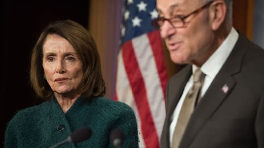 US Senate Minority Leader Chuck Schumer, Democrat of New York, and House Democratic Leader Nancy Pelosi, speak about the Omnibus budget deal during a press conference at the US Capitol in Washington, DC, March 22, 2018.