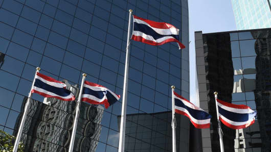 Thai flags are seen outside of the Stock Exchange of Thailand in Bangkok on January 8, 2018.