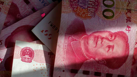 China isn't likely to let the yuan weaken much further, survey of experts shows