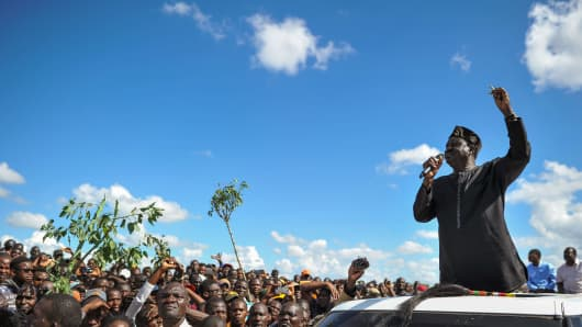 Opposition leader Raila Odinga addresses his supporters during demonstrations in the Umoja subururb of Nairobi, Kenya, on November 28, 2017.
