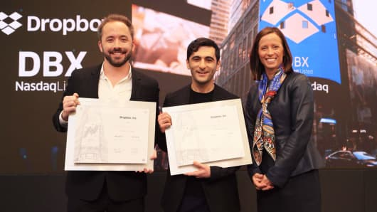 Dropbox co-founders Drew Houston and Arash Ferdowsi with Adena Friedman.