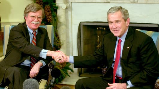 President George W. Bush (R) and Ambassador to the UN John Bolton (L) meet in the Oval Office of the White House December 4, 2006 in Washington, DC. Bush accepted Bolton's resignation as Ambassador to the United Nations when his term is up in January 2007.
