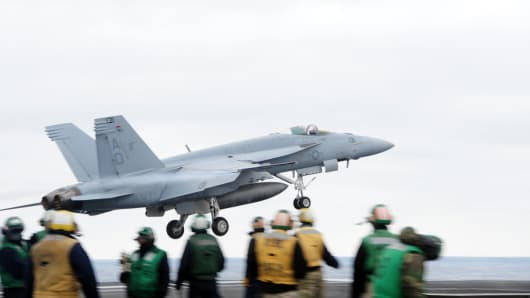 An F/A-18 Super Hornet attached to the Gladiators of Strike Fighter Squadron (VFA) 106 takes off from the flight deck of the aircraft carrier USS George H.W. Bush (CVN 77).