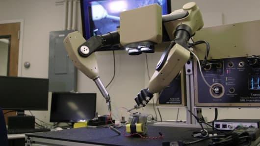 SRI International's Taurus robot diffusing a mock bomb