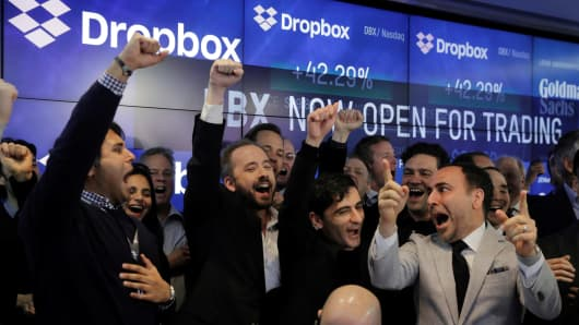 Dropbox Inc. co-founders Drew Houston and Arash Ferdowsi celebrate while watching the initial trade of Dropbox (DBX) as it is listed for the company's initial public offering (IPO) at the Nasdaq Market Site in New York City, U.S., March 23, 2018.