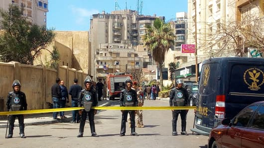 A general view shows Egyptian riot police cordoning off the street at the site of a bomb attack in the northern port city of Alexandria, which hit a convoy of the city's security chief, on March 24, 2018.