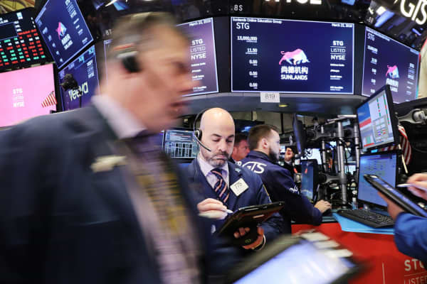 Traders work on the floor of the New York Stock Exchange on Mar. 23, 2018 in New York City.
