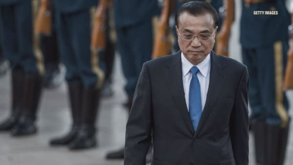 China's premier pledges open markets in an attempt to avoid trade war with US