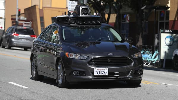 An Uber self-driving car drives down 5th Street on March 28, 2017 in San Francisco, California. Cars in Uber's self-driving cars are back on the roads after the program was temporarily halted following a crash in Tempe, Arizona on Friday.