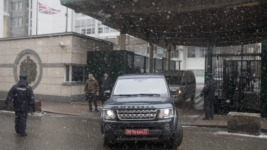 Vehicles allegedly carrying British diplomats expelled by Russia, leave the British Embassy in Moscow, Russia, Friday, March 23, 2018.