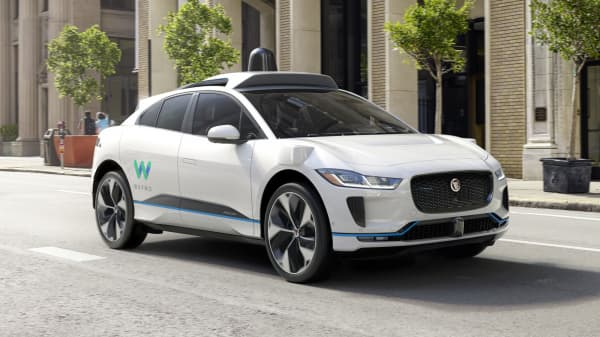 Jaguar's I-Pace SUV, modified with self-driving technology, will be used in Waymo's ride-hailing fleet.