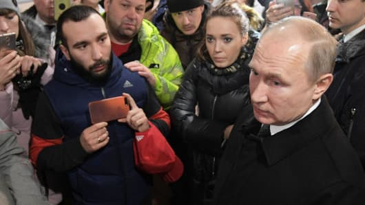 Russian President Vladimir Putin meets with locals and relatives of persons missing in a fire in a shopping mall in the Siberian city of Kemerovo, Russia March 27, 2018.