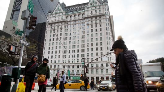 Pedestrians near the Plaza Hotel in New York.