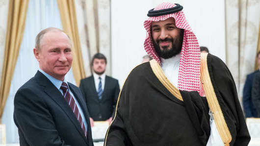Russian President Vladimir Putin (L) shakes hands with Saudi Deputy Crown Prince and Defence Minister Mohammed bin Salman during a meeting at the Kremlin in Moscow on May 30, 2017.