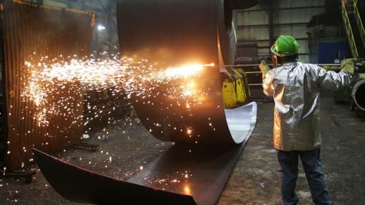 A worker cuts a steel coil at the Novolipetsk Steel PAO steel mill in Farrell, Pennsylvania, March 9, 2018.