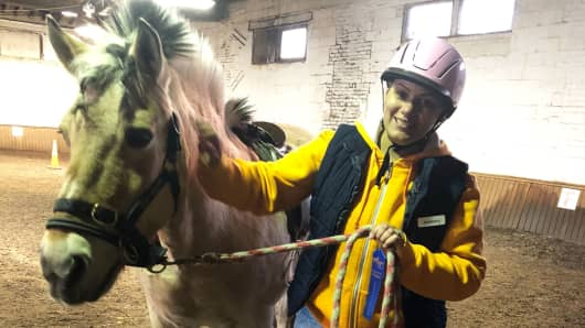 Jasmary Alfonso-Andaluz rides horses for therapy. She received Abbott's proclaim device with BurstDR stimulation after nearly a decade of pain.