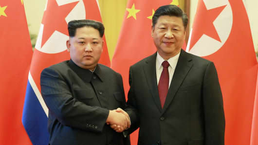 North Korean leader Kim Jong Un shakes hands with Chinese President Xi Jinping in Beijing, as he paid an unofficial visit to China, in this undated photo released by North Korea's Korean Central News Agency (KCNA) in Pyongyang March 28, 2018.