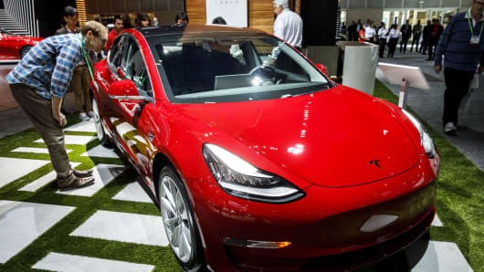The Tesla Model 3 vehicle is displayed ahead of the Los Angeles Auto Show in Los Angeles.