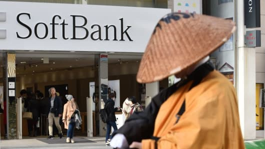 The logo of Japanese mobile provider SoftBank is displayed at an entrance of a shop in Tokyo's shopping district Ginza on February 8, 2017.