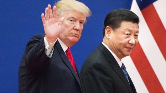 U.S. President Donald Trump and China's President Xi Jinping leave a business leaders event at the Great Hall of the People in Beijing on November 9, 2017.