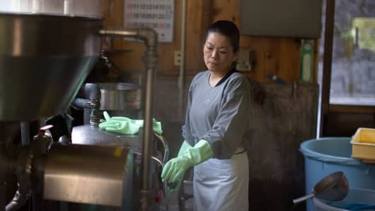 A woman works in a small tofu factory in Ochiai, Miyoshi, Japan.