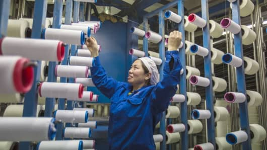 A textile worker at a factory in Nantong city, located in the Jiangsu province, China.