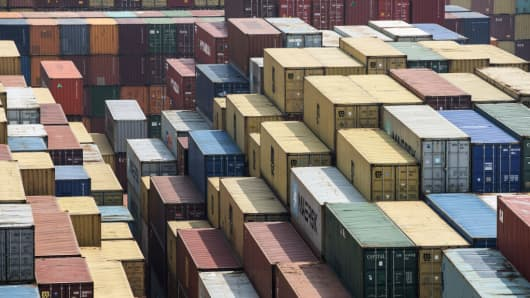 Shipping containers stand in a terminal at the Yangshan Deep Water Port in Shanghai, China, on Mar. 23, 2018.