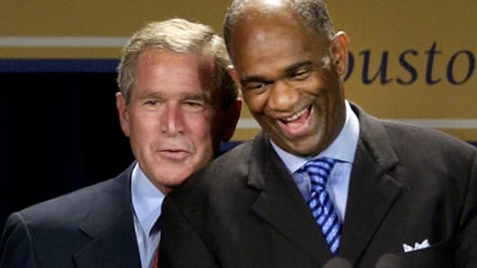 President George W. Bush, left, shares a laugh with Pastor Kirbyjon Caldwell as they are introduced during a fundraiser for the Power Center, a huge multi-use complex in southwest Houston, which is celebrating its' 10th anniversary Friday, Sept. 12, 2003.