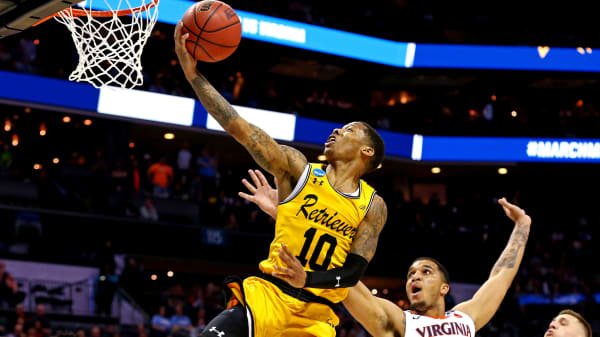 UMBC Retrievers guard Jairus Lyles (10) shoots the ball against Virginia Cavaliers forward Isaiah Wilkins (21) during the second half in the first round of the 2018 NCAA Tournament at Spectrum Center.