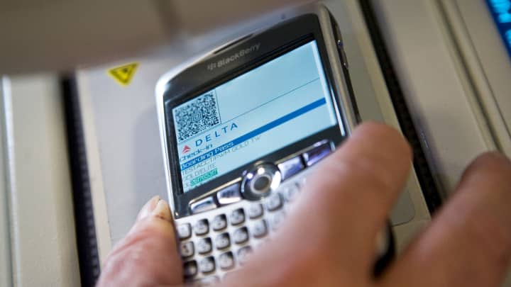 A boarding pass on a Blackberry phone, is scanned at LaGuardia Airport. Delta Air Lines partnered with the TSA to launch a paperless boarding pass system at LaGuardia Airport, June 17, 2008.