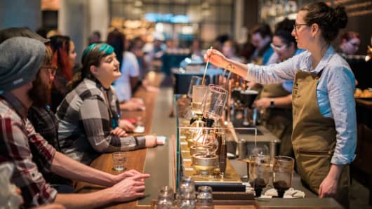 A Starbucks barista demonstrates how to brew coffee using a siphon at the Reserve Store in Seattle.