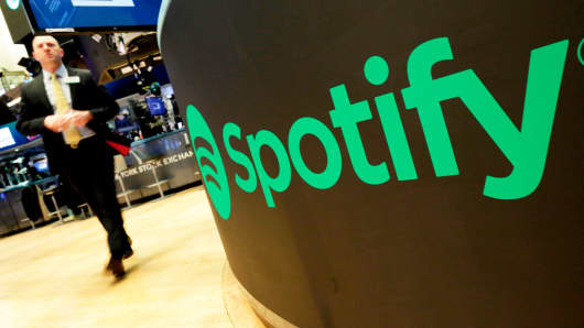 A trading post sports the Spotify logo on the floor of the New York Stock Exchange, Tuesday, April 3, 2018.