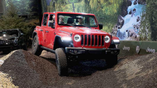 Guests drive a Jeep Wrangler Rubicon on a simulated off-road course at the Chicago Auto Show on February 8, 2018 in Chicago.