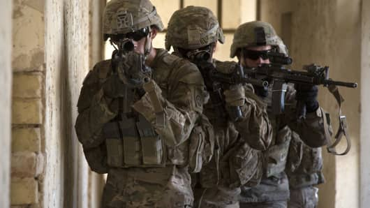 U.S. Army paratroopers assigned to Bravo Troop, 5th Squadron, 73rd Cavalry Regiment, 3rd Brigade, 82nd Airborne Division, maneuver through a hallway as part of squad level training at Camp Taji, Iraq.