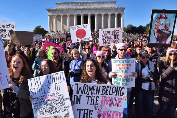 Attendees cheer during the Women's March on Saturday, January 20, 2018, at the Lincoln Memorial in Washington, D.C.