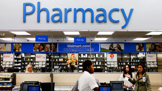A customer walks past the pharmacy at a Walmart in Torrance, California.