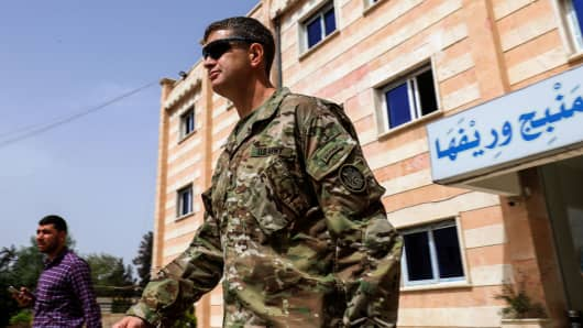 U.S. Army Maj. Gen. James B. Jarrard leaves following a meeting in the YPG-held northern Syrian city of Manbij, where the US has a military presence, on March 22, 2018.