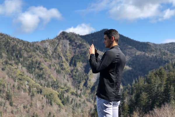 """Jason Varney in the Smoky Mountains in Tennessee. """"I was trying to get as high as I could to get a signal on my phone [to play HQ Trivia],"""" he tells CNBC Make It."""